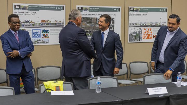Valley Metro CEO Scott Smith shakes hands with Secretary Buttigieg
