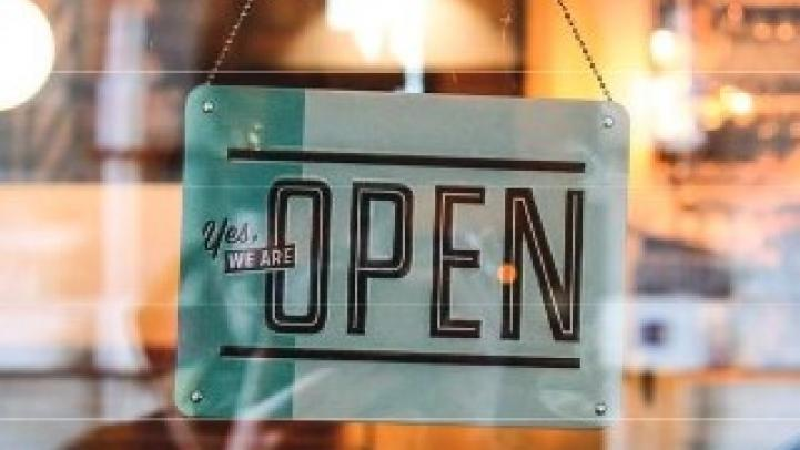 """A business """"open"""" sign in a window"""