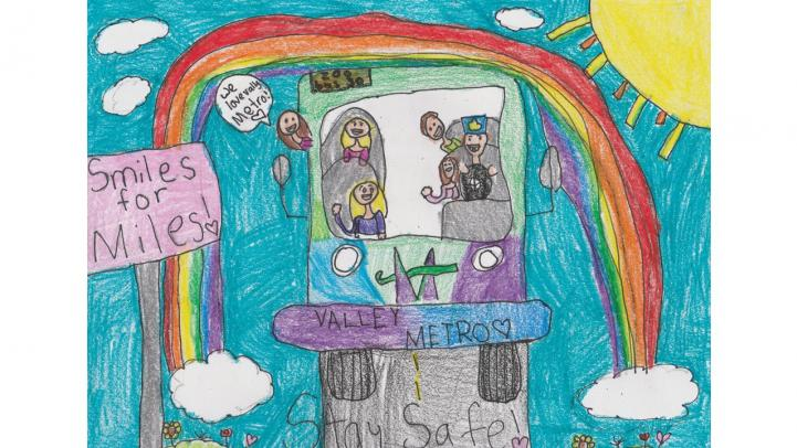 "Artwork showing a Valley Metro bus driving down a street with a rainbow over it and a sign reading ""Smiles for miles."""