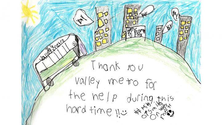 "Artwork of a bus driving into the city with the caption ""Thank you Valley Metro for the help during this hard time!"""