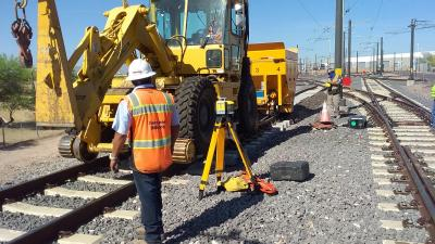 Track crew placing ballast with pettbone and trailer