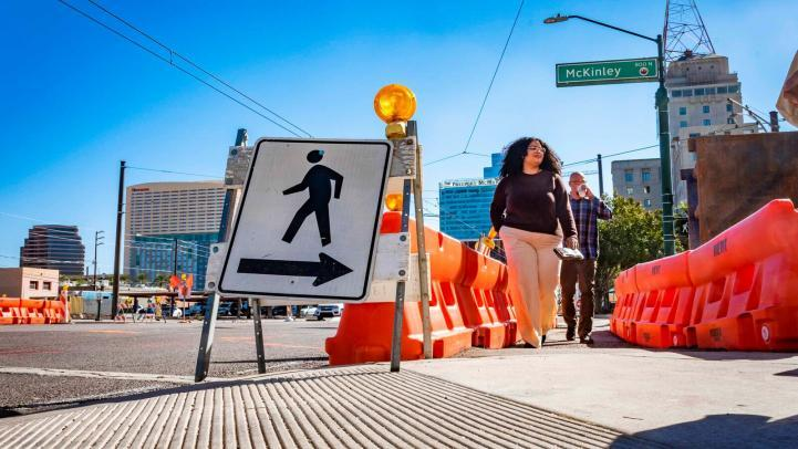 Pedestrians crossing construction zone on Central Avenue and McKinley Street.