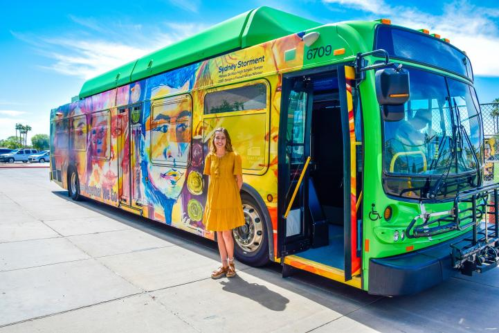 Sydney Storment pictured next to her bus