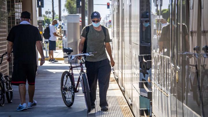 Bicyclist on light rail platform
