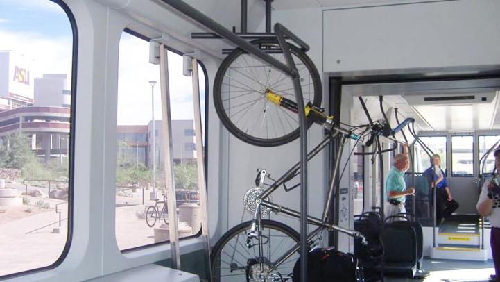 A bicycle propped up on a rack in a train
