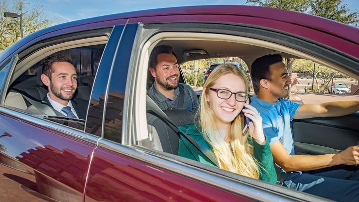 Carpoolers smiling.
