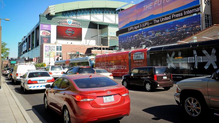 Cars next to Valley Metro Rail