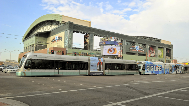Light rail train rides by Chase Field