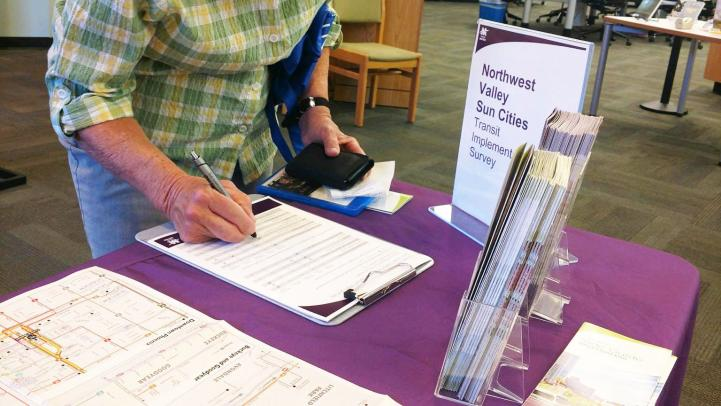 Sun City woman completing a paper survey as part of the Existing Conditions phase.