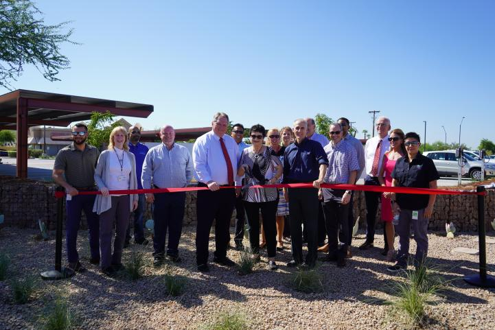 Photo depicting City of Peoria officials and Valley Metro CEO Scott Smith cutting a red ribbon and officially opening the park-and-ride for service.