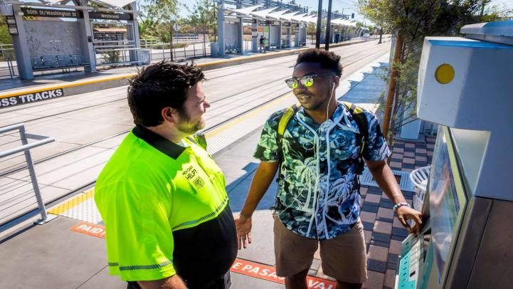 Customer Experience Coordinator at a farebox helping young man