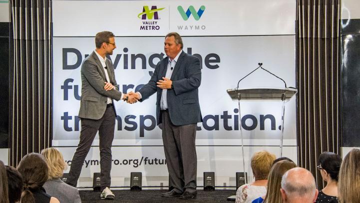 Shaun Stewart, Waymo Chief Business Development Officer and Scott Smith, Valley Metro CEO shake hands.