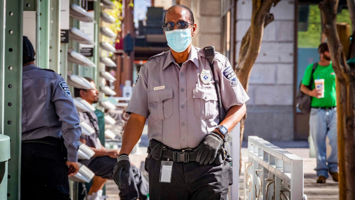 Security person wearing a protective mask.