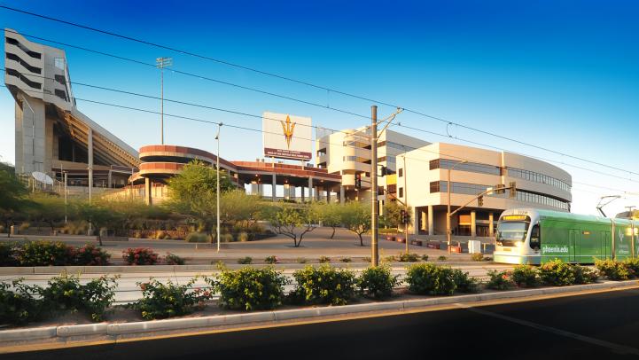 Light rail train rides by Sun Devil Stadium