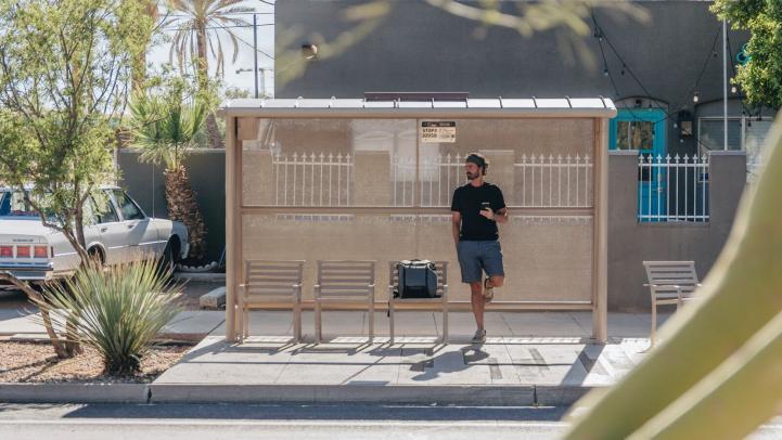 Man waits at bus stop