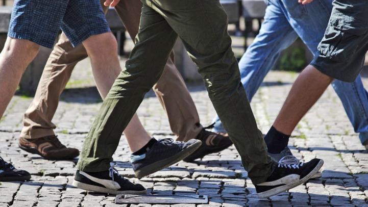 Legs of people walking.
