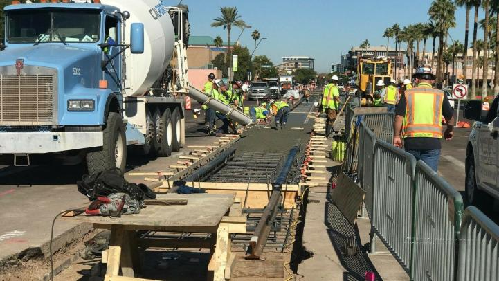 Construction crews work on the Tempe Streetcar system