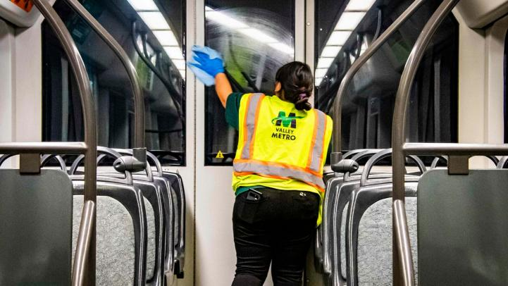 Crews clean Valley Metro train after a day of service