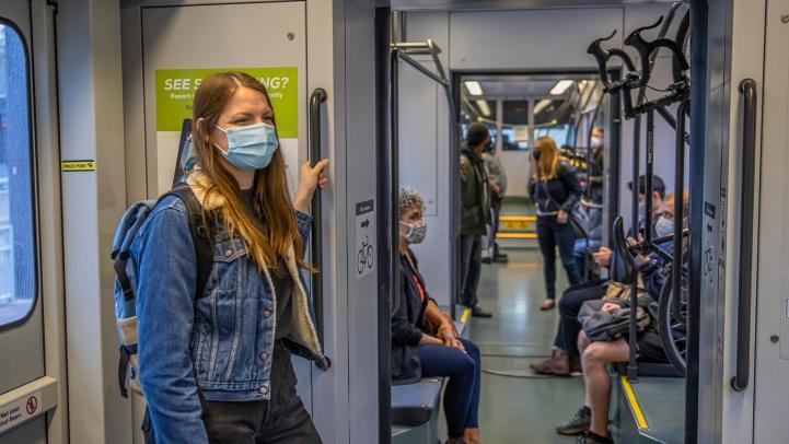 light rail passengers wearing face masks