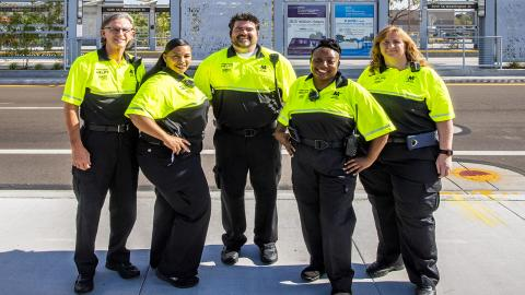 Group of Customer Experience Coordinators at light rail station