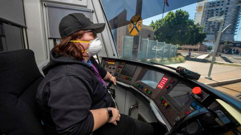 light rail operator wearing face covering