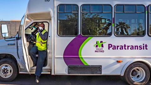 driver exiting paratransit vehicle