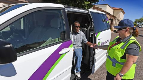 Paratransit driver assisting customer