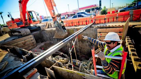 Crews work on installing new light rail track
