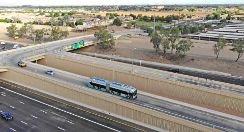 View of light rail from a freeway ramp