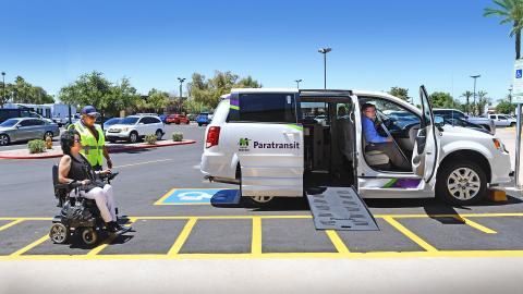 Wheelchair rider getting ready to get in a Paratransit Van