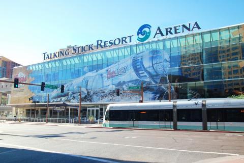 Light rail passes in front of Talking Stick Resort arena.