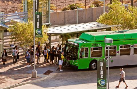 Riders wait in line for Valley Metro Bus