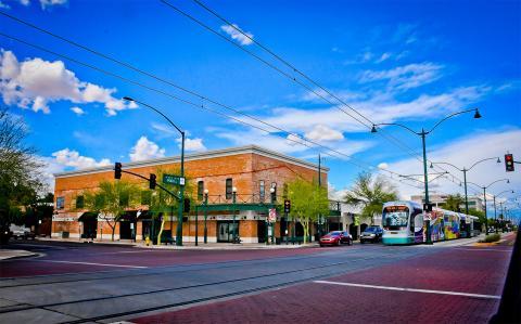 light rail train drives along main street