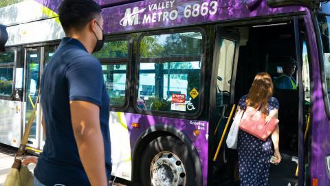 Riders boarding a Valley Metro bus